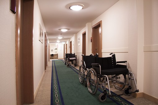 care homes corridor with wheelchair and rooms